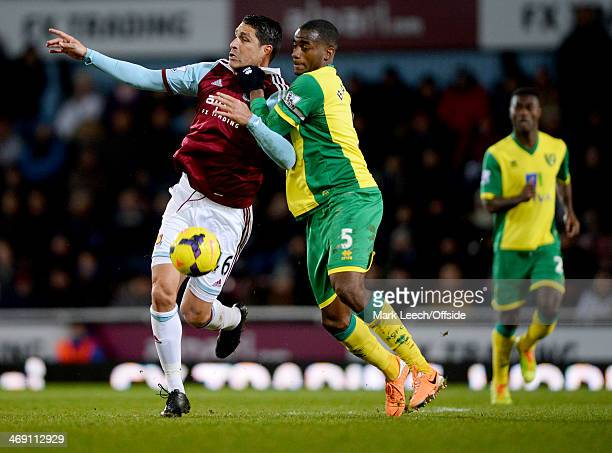 Marco Borriello of West Ham United tangles with Sebastien Bassong of Norwich City during the Premier League match between West Ham United and Norwich...