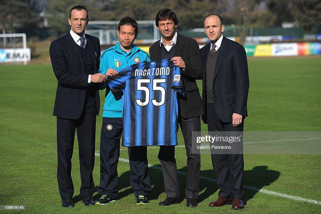 Marco Branca, Yuto Nagatomo, Leonardo and Piero Ausilio pose together as Yuto Nagatomo signs for FC Internazionale Milano at Centro Sportivo Angelo Moratti on February 4, 2011 in Como, Italy.