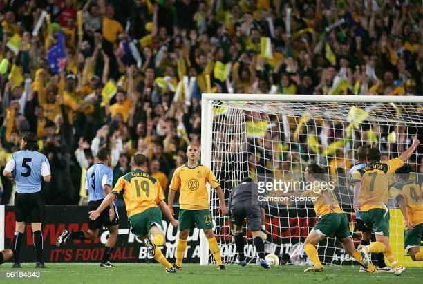 Marco Bresciano of the Socceroos celebrates scoring a goal during the second leg of the 2006 FIFA World Cup qualifying match between Australia and...