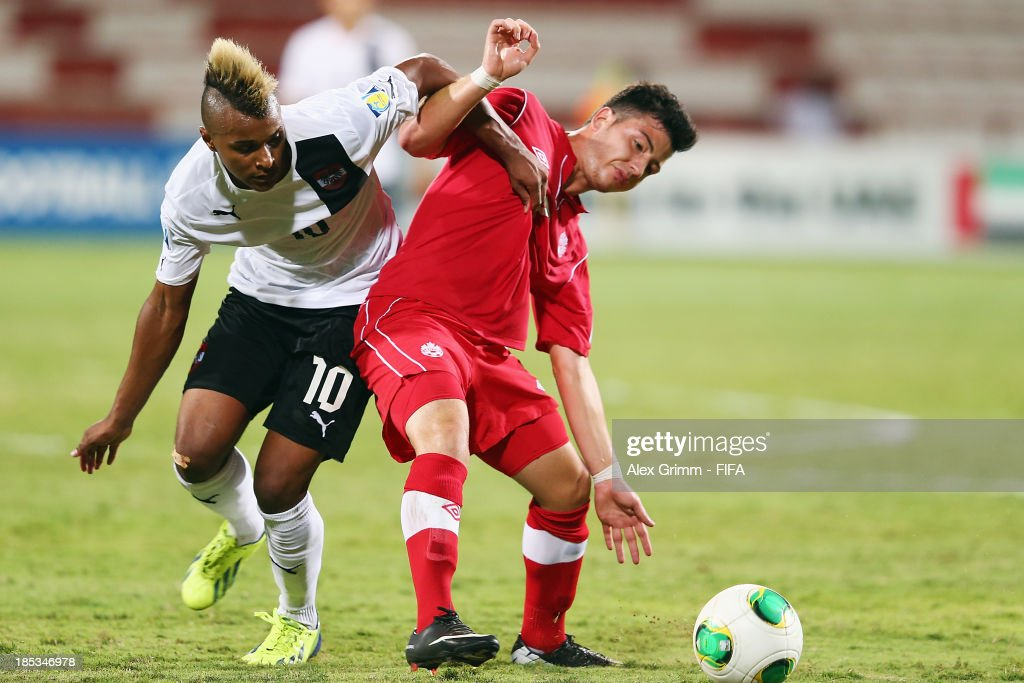 Marco Bustos (R) of Canada is challenged by Valentin Lazaro of Austria during the FIFA U-17 World Cup UAE 2013 Group E match between Canada and Austria at Al Rashid Stadium on October 19, 2013 in Dubai, United Arab Emirates.