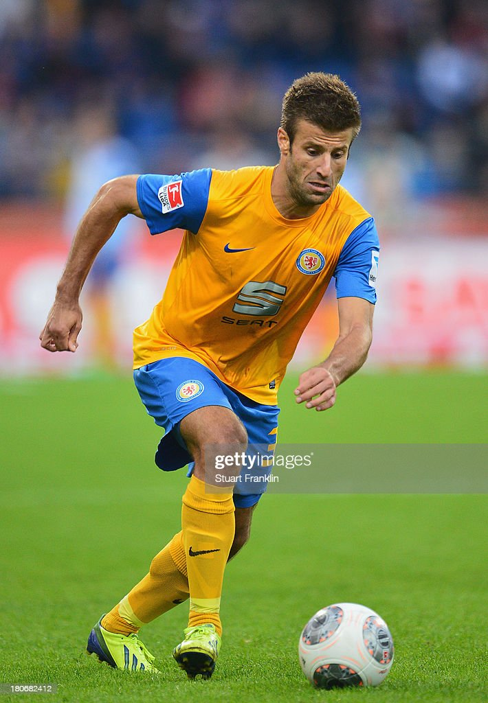<a gi-track='captionPersonalityLinkClicked' href=/galleries/search?phrase=Marco+Caligiuri&family=editorial&specificpeople=729372 ng-click='$event.stopPropagation()'>Marco Caligiuri</a> of Braunschweig in action during the Bundesliga match between Eintracht Braunschweig and 1. FC Nuernberg at Eintracht Stadion on September 15, 2013 in Braunschweig, Germany.