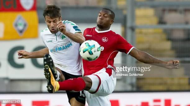 Marco Caligiuri of Greuther Fuerth challenges Gervance Kastaneer of 1FC Kaiserslautern during the Second Bundesliga match between 1 FC Kaiserslautern...