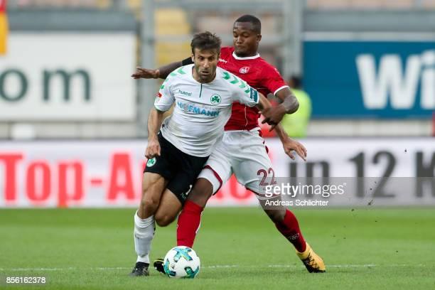 Marco Caligiuri of Greuther Fuerth challenges Gervane Kastaneer of 1FC Kaiserslautern during the Second Bundesliga match between 1 FC Kaiserslautern...