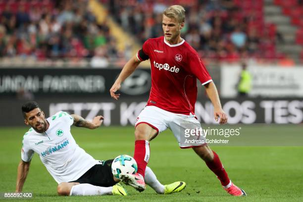 Marco Caligiuri of Greuther Fuerth challenges Sebastian Andersson of 1FC Kaiserslautern during the Second Bundesliga match between 1 FC...