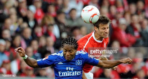 Marco Caligiuri of Mainz battles for the ball with Ze Roberto of Hamburg during the Bundesliga match between FSV Mainz 05 and Hamburger SV at...