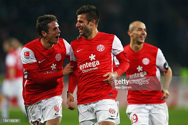 Marco Caligiuri of Mainz celebrates his team's second goal with team mates Nicolai Mueller and Elkin Soto during the Bundesliga match between FSV...