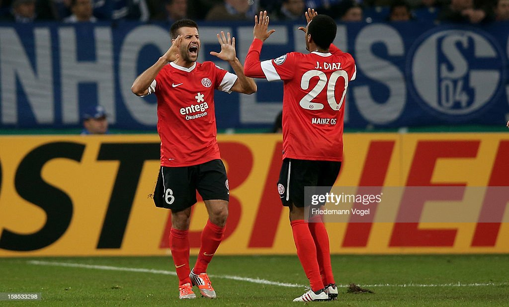Marco Caliguri (L) of Mainz celebrates scoring the first goal with Junior Diaz (R) during the DFB cup round of sixteen match between FC Schalke 04 and FSV Mainz 05 at Veltins-Arena on December 18, 2012 in Gelsenkirchen, Germany.