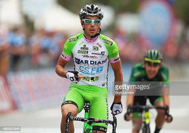Marco Canola of Italy and BardianiCSF celebrates crossing the finish line to win the thirteenth stage of the 2014 Giro d'Italia a 157km stage between...