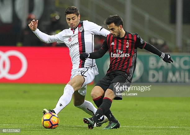 Marco Capuano of Cagliari Calcio competes for the ball with Suso of AC Milan during the Serie A match between AC Milan and Cagliari Calcio at Stadio...