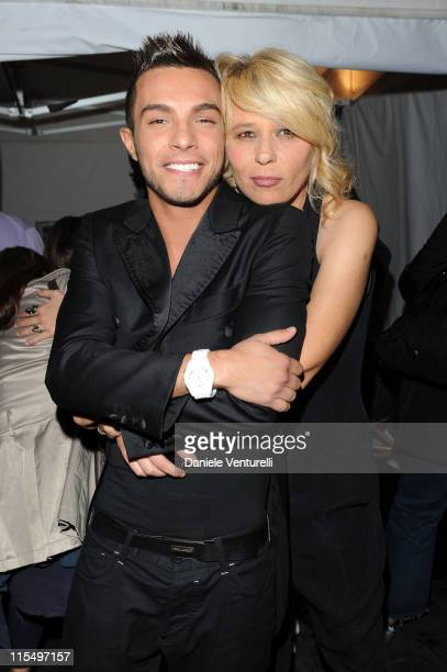 ACCESS *** Marco Carta and Maria De Filippi attend the Wind Music Awards Backstage at the Arena of Verona on May 29 2010 in Verona Italy