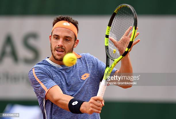 Marco Cecchinato of Italy hits a backhand during the Mens Singles first round match against Nick Kyrgios of Australia on day one of the 2016 French...