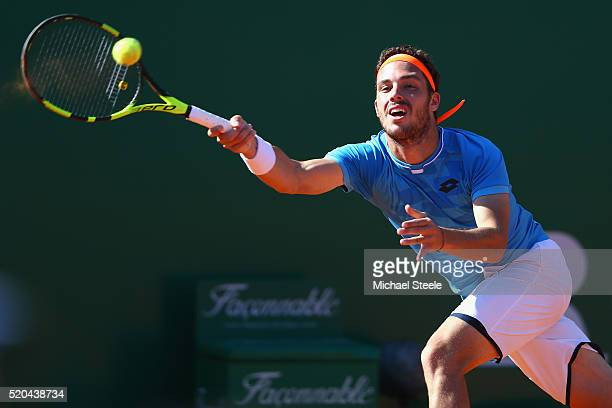 Marco Cecchinato of Italy hits a forehand return during his straight sets defeat against Milos Raonic of Canada during day two of the Monte Carlo...