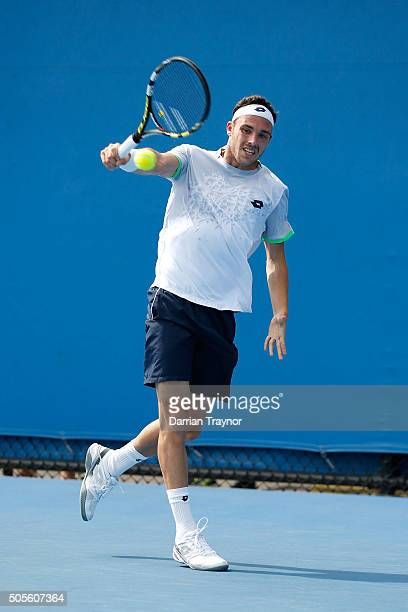 Marco Cecchinato of Italy plays a backhand in his first round match against Nicolas Mahut of France during day two of the 2016 Australian Open at...