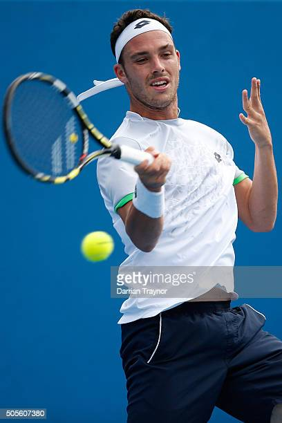 Marco Cecchinato of Italy plays a forehand in his first round match against Nicolas Mahut of France during day two of the 2016 Australian Open at...