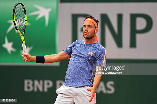 Marco Cecchinato of Italy reacts during the Mens Singles first round match against Nick Kyrgios of Australia on day one of the 2016 French Open at...
