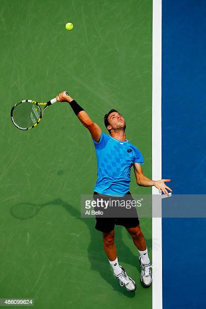 Marco Cecchinato of Italy serves against Mardy Fish of the United States during their Men's Singles First Round match on Day One of the 2015 US Open...