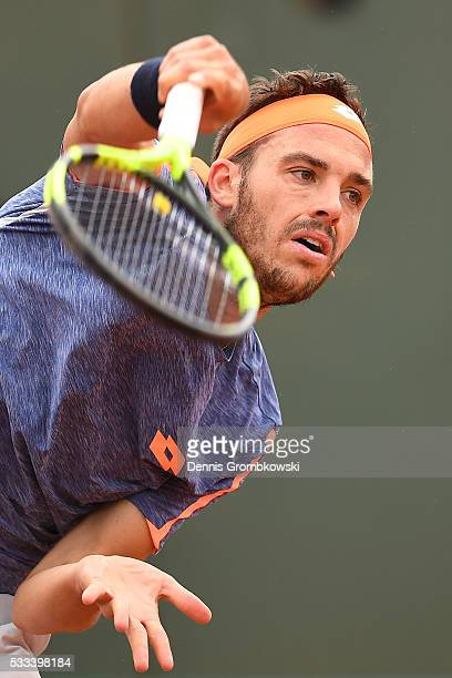 Marco Cecchinato of Italy serves during the Mens Singles first round match against Nick Kyrgios of Australia on day one of the 2016 French Open at...