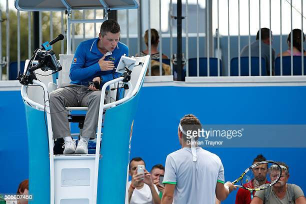 Marco Cecchinato of Italy talks to the chair umpire in his first round match against Nicolas Mahut of France during day two of the 2016 Australian...