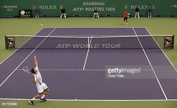 Marco Chiudinelli of Switzerland serves against TsungHua Yang of Taiwan during the Day 1 of the 2009 Shanghai ATP Master 1000 at the Qi Zhong Tennis...