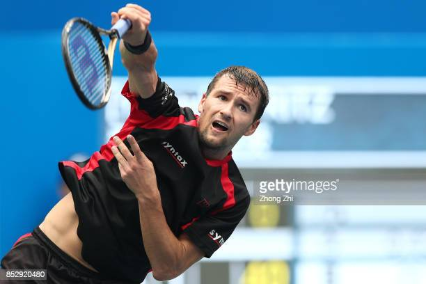 Marco Chiudinelli of Switzerland serves during the match against Taylor Fritz of the United States during Qualifying second round of 2017 ATP Chengdu...