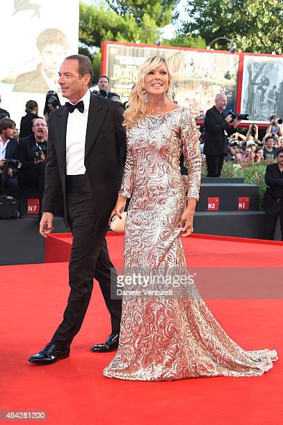 Marco Costantini and Matilde Brandi attend the Opening Ceremony and 'Birdman' premiere during the 71st Venice Film Festival at Palazzo Del Cinema on...