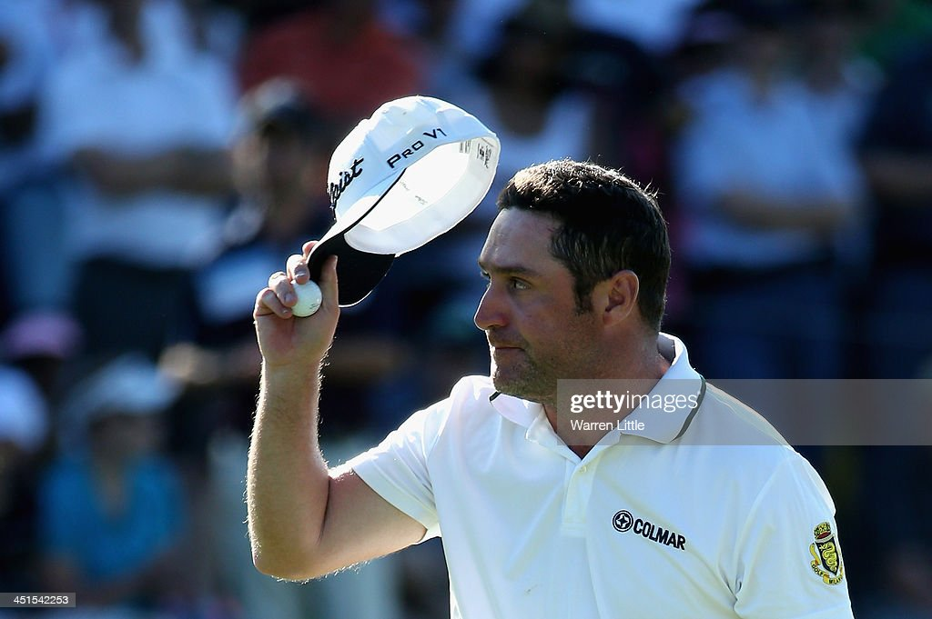 Marco Crespi of Italy acknowledges the crowd on the 18th green during the third round of the South African Open Championship at Glendower Golf Club on November 23, 2013 in Johannesburg, South Africa.