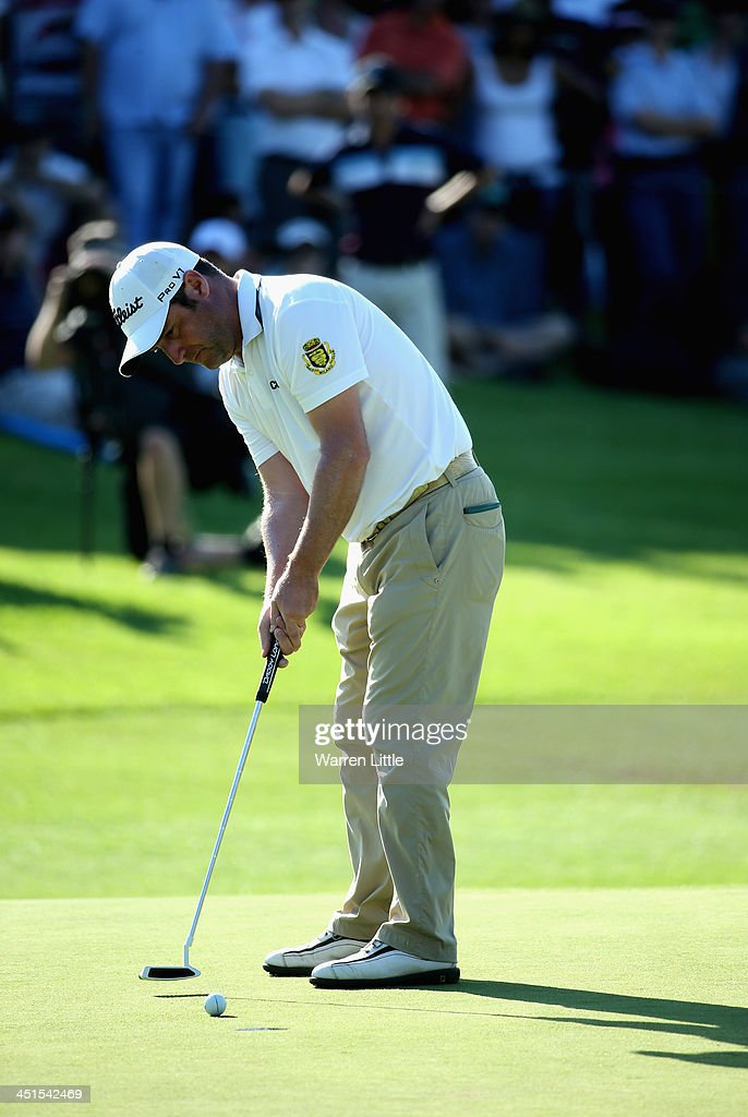 Marco Crespi of Italy putts on the 18th green during the third round of the South African Open Championship at Glendower Golf Club on November 23, 2013 in Johannesburg, South Africa.