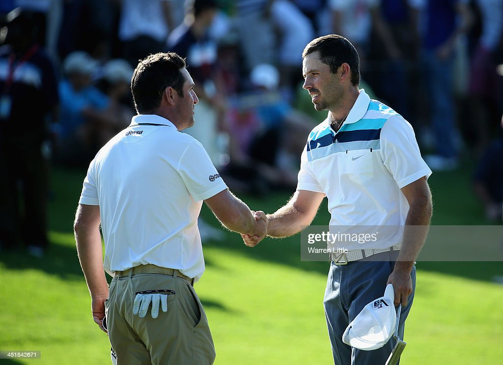 Marco Crespi of Italy shakes hands with <a gi-track='captionPersonalityLinkClicked' href=/galleries/search?phrase=Charl+Schwartzel&family=editorial&specificpeople=213793 ng-click='$event.stopPropagation()'>Charl Schwartzel</a> of South Africa on the 18th green during the third round of the South African Open Championship at Glendower Golf Club on November 23, 2013 in Johannesburg, South Africa.