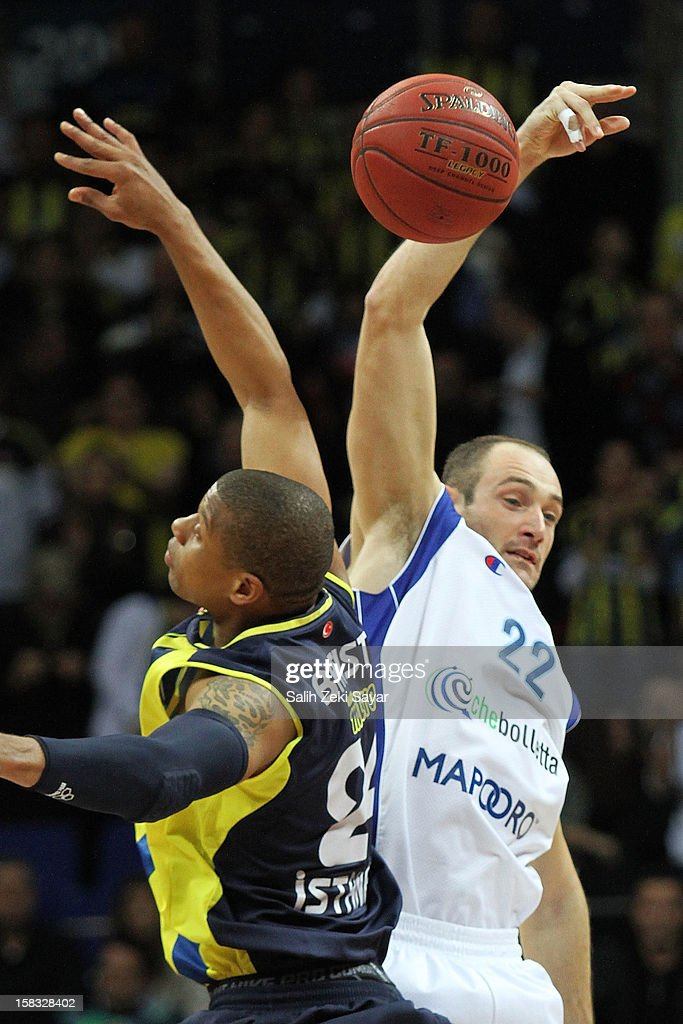 Marco Cusin of Mapooro Cantu and Michael Batiste of Fenerbahce Ulker reaching for the first ball of the 20122013 Turkish Airlines Euroleague Regular...