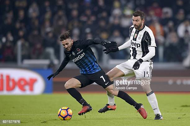 Marco D'Alessandro of Atalanta BC and Andrea Barzagli of Juventus FC compete for the ball during the TIM Cup match between Juventus FC and Atalanta...