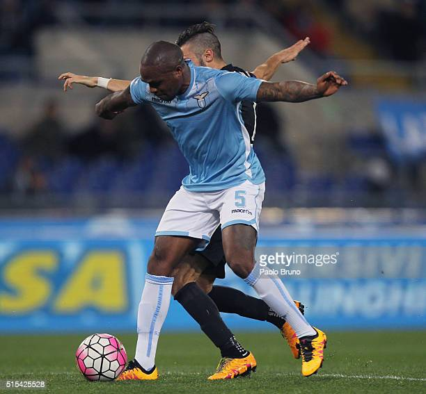 Marco D'Alessandro of Atalanta BC competes for the ball with Edson Braafheid of SS Lazio during the Serie A match between SS Lazio and Atalanta BC at...