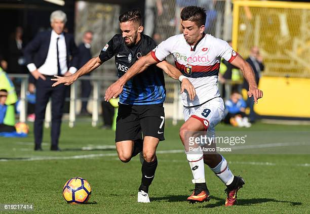 Marco D'Alessandro of Atalanta BC competes for the ball with Giovanni Simone of Genoa CFC during the Serie A match between Atalanta BC and Genoa CFC...