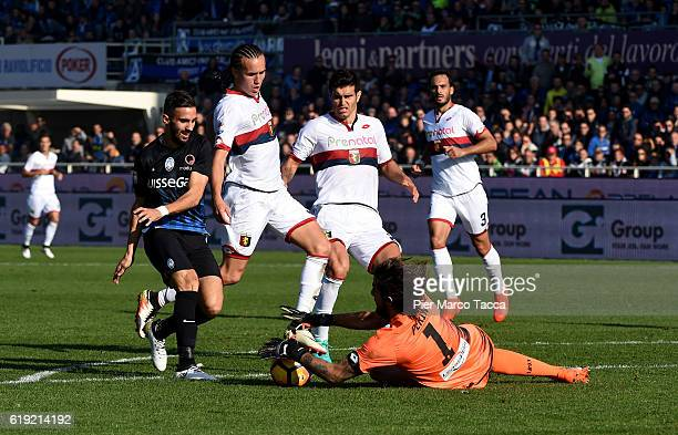 Marco D'Alessandro of Atalanta BC competes for the ball with Perin Mattia goalkeeper of Genoa CFC during the Serie A match between Atalanta BC and...