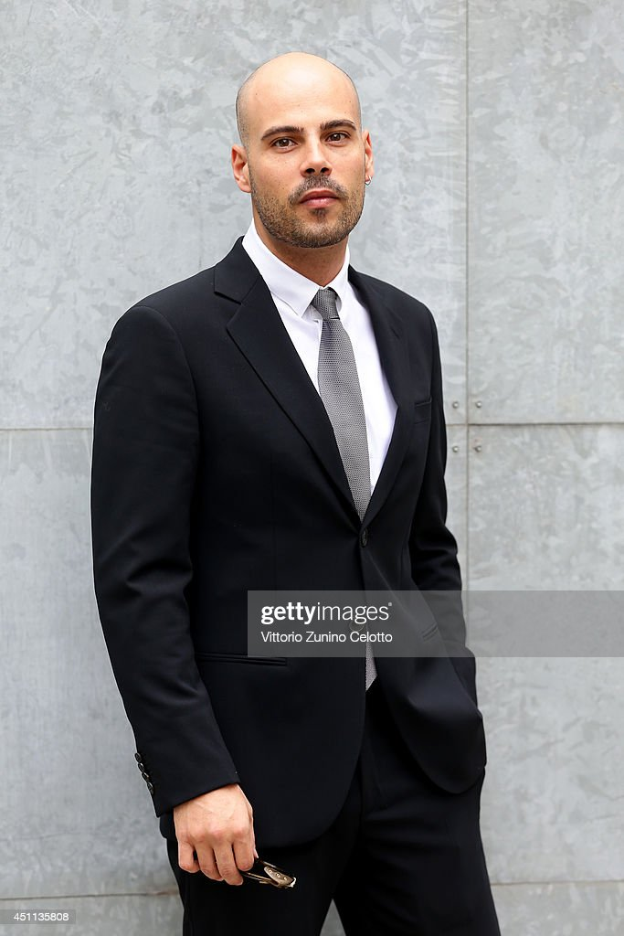 <a gi-track='captionPersonalityLinkClicked' href=/galleries/search?phrase=Marco+D%27Amore&family=editorial&specificpeople=7302807 ng-click='$event.stopPropagation()'>Marco D'Amore</a> attends Giorgio Armani show during Milan Menswear Fashion Week Spring Summer 2015 on June 24, 2014 in Milan, Italy.