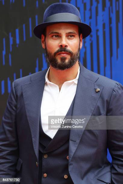 Marco D'Amore walks the red carpet ahead of the 'Brutti E Cattivi' screening during the 74th Venice Film Festival at Sala Darsena on September 7 2017...