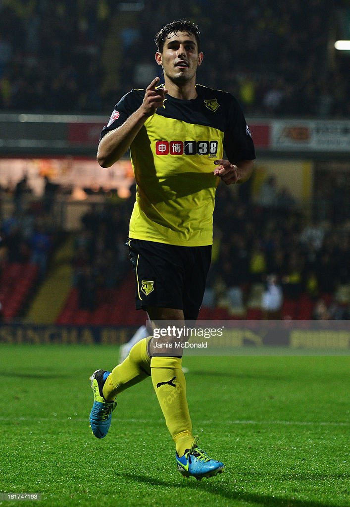 <a gi-track='captionPersonalityLinkClicked' href=/galleries/search?phrase=Marco+Davide+Faraoni&family=editorial&specificpeople=7580410 ng-click='$event.stopPropagation()'>Marco Davide Faraoni</a> of Watford celebrates as he scores their second goal during the Capital One Cup Third Round match between Watford and Norwich City at Vicarage Road on September 24, 2013 in Watford, England.
