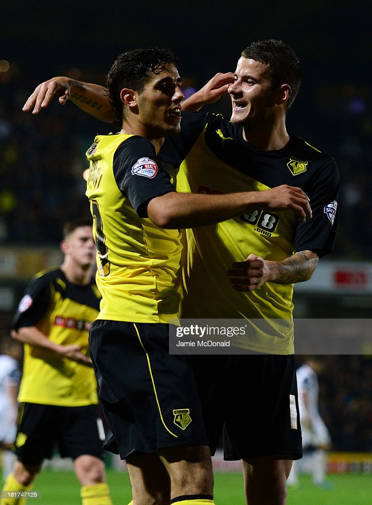 <a gi-track='captionPersonalityLinkClicked' href=/galleries/search?phrase=Marco+Davide+Faraoni&family=editorial&specificpeople=7580410 ng-click='$event.stopPropagation()'>Marco Davide Faraoni</a> of Watford (L) celebrates with team mate Daniel Pudil as he scores their second goal during the Capital One Cup Third Round match between Watford and Norwich City at Vicarage Road on September 24, 2013 in Watford, England.