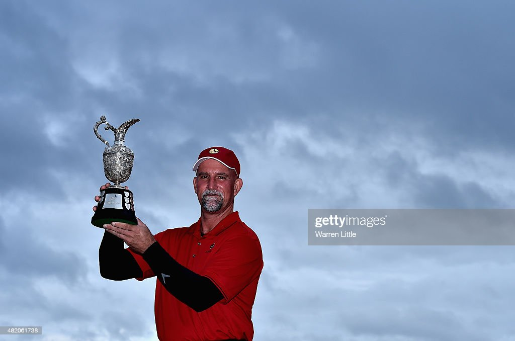 Marco Dawson of the USA poses with the trophy after winning The Senior Open Championship on the Old Course at Sunningdale Golf Club on July 26 2015...