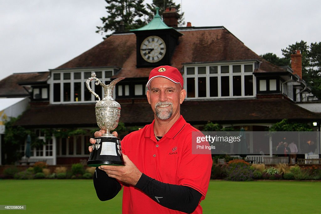 Marco Dawson of United States poses with the trophy after the final round of The Senior Open Championship played at the Old Course Sunningdale Golf...