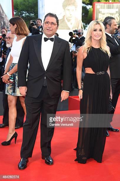 Marco De Benedetti and Paola Ferrari attend the Opening Ceremony and 'Birdman' premiere during the 71st Venice Film Festival at Palazzo Del Cinema on...