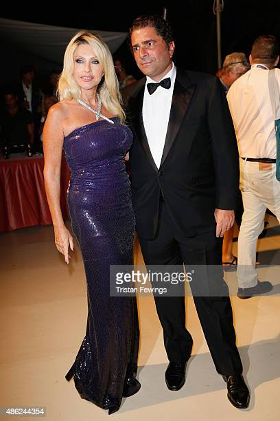 Marco De Benedetti and Paola Ferrari attend the opening dinner during the 72nd Venice Film Festival on September 2 2015 in Venice Italy