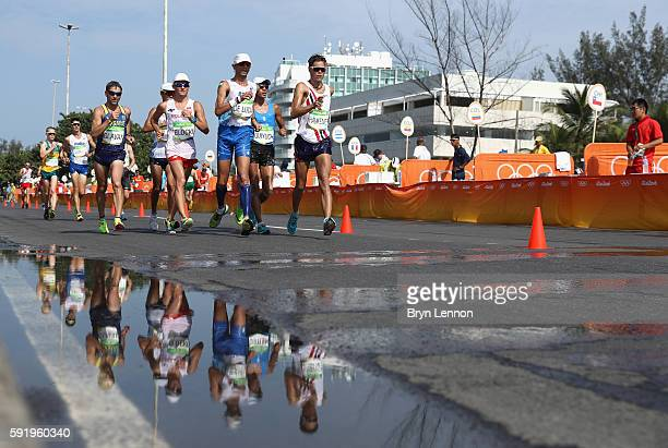 Marco de Luca of Italy and Havard Haukenes of Norway lead the pack during the Men's 50km Race Walk on Day 14 of the Rio 2016 Olympic Games at Pontal...