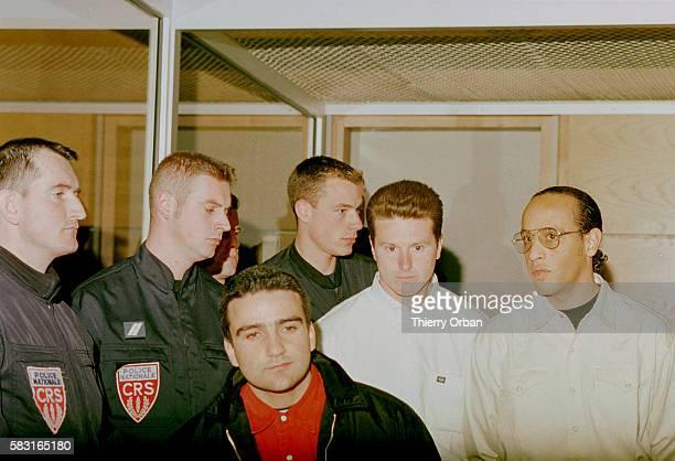 Marco Di Caro Lucien Ferri and Stephane Ali Guechguech under heavy escort
