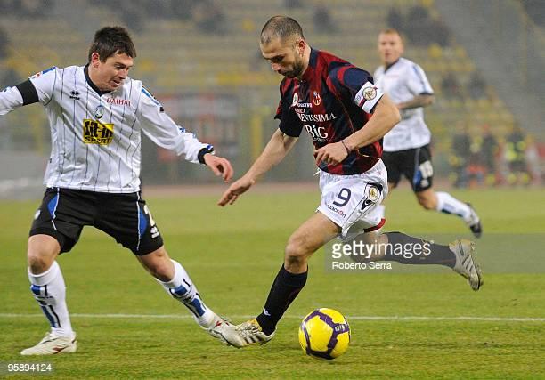 Marco Di vaio of Bologna competes with Leonardo Talamonti of Atalanta during the Serie A match between Bologna and Atalanta at Stadio Renato Dall'Ara...