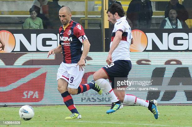 Marco Di Vaio of Bologna FC competes the ball with Kakha Kaladze of Genoa CFC during the Serie A match between Bologna FC and Genoa CFC at Stadio...