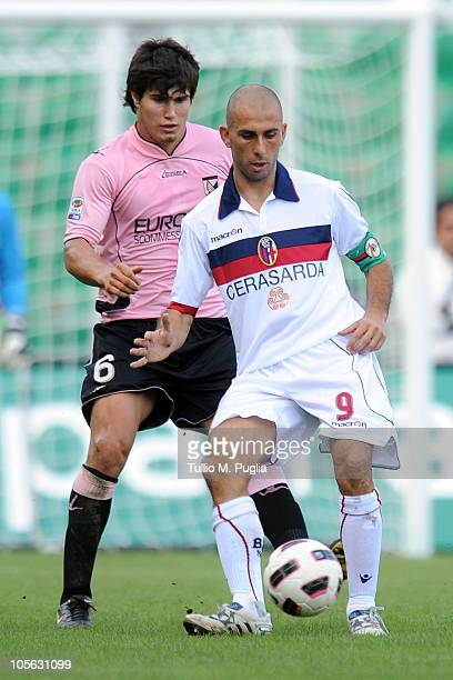 Marco Di Vaio of Bologna holds off the challenge from Ezequiel Munoz of Palermo during the Serie A match between US Citta di Palermo and Bologna FC...