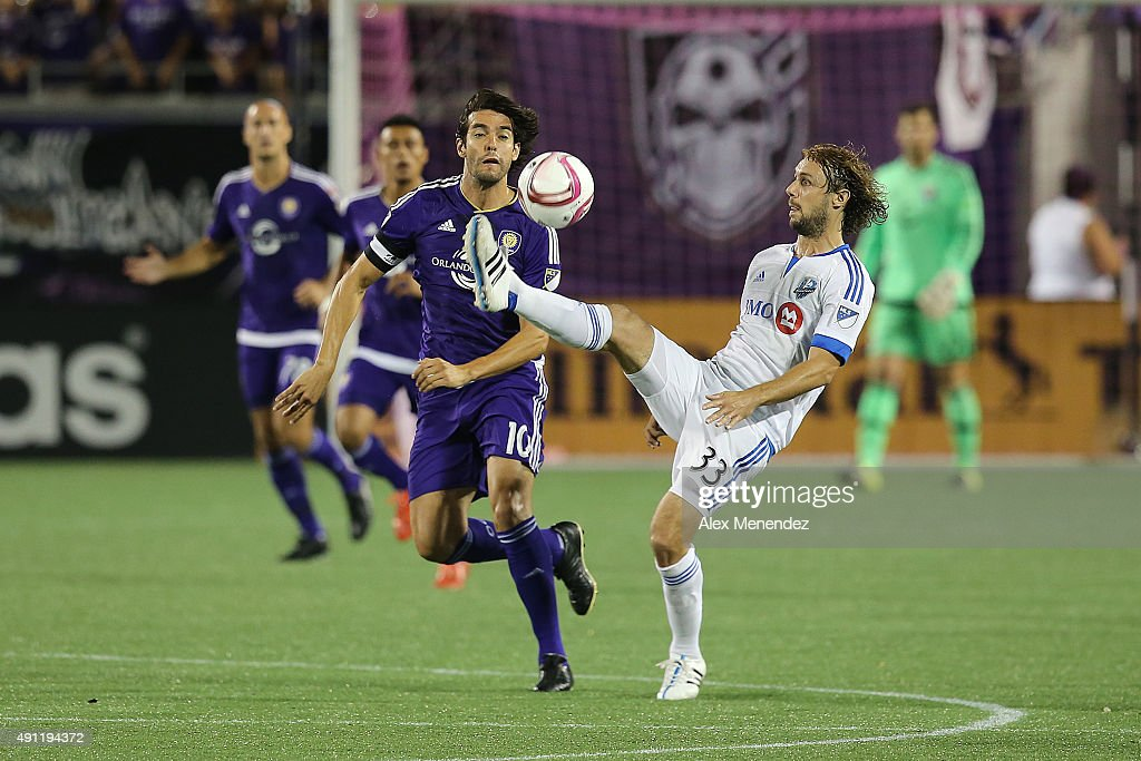 Marco Donadel #33 of Montreal Impact kicks the ball in front of Kaka #10 of Orlando City SC during an MLS soccer match between the Montreal Impact and the Orlando City SC at the Orlando Citrus Bowl on October 3, 2015 in Orlando, Florida. Orlando won the match 2-1.