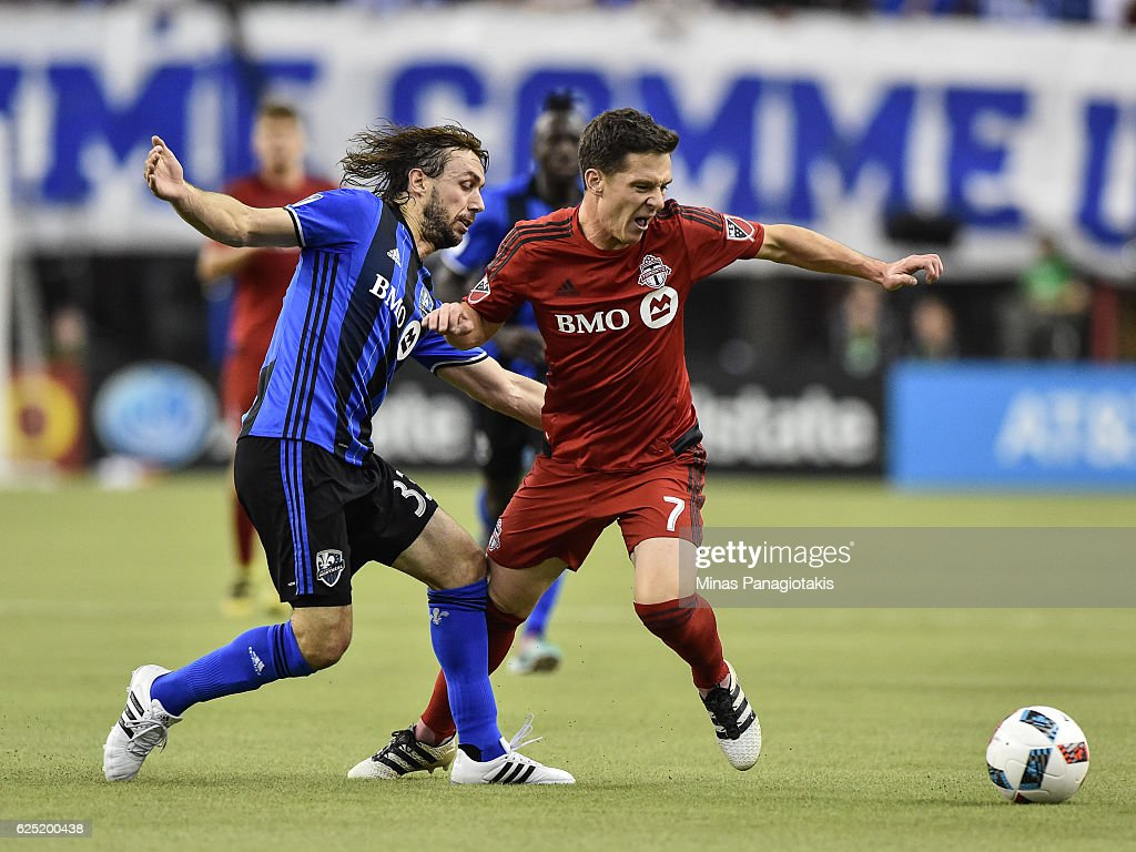 Marco Donadel #33 of the Montreal Impact and Will Johnson #7 of the Toronto FC battle for the ball during leg one of the MLS Eastern Conference finals at Olympic Stadium on November 22, 2016 in Montreal, Quebec, Canada. The Montreal Impact defeated the Toronto FC