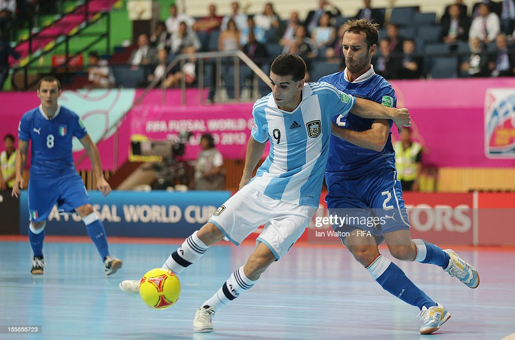 Marco Ercolessi of Italy is tackled by Cristian Borruto of Argentina during the FIFA Futsal World Cup Thailand 2012, Group D match between Argentina and Italy at Nimibutr Stadium on November 5, 2012 in Bangkok, Thailand.