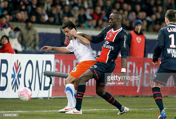 Marco Estrada of Montpellier Herault and Mohamed Sissoko of Paris Saint Germain during the French Ligue 1 between Paris Saint Germain and Montpellier...